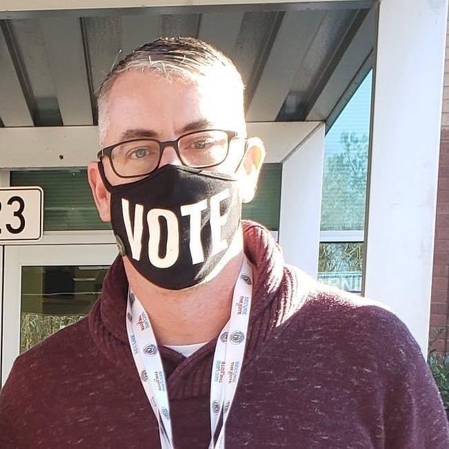 Jeffrey Danovich headshot with a VOTE mask on